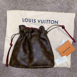 Louis Vuitton pouch bag .